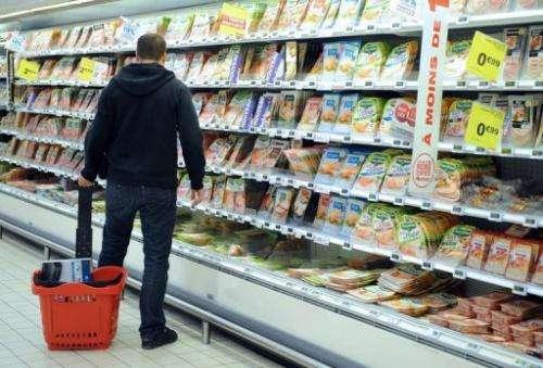 A man does his shopping in a supermarket in Saint-Sebastien-sur-Loire, western France on December 27, 2012.
