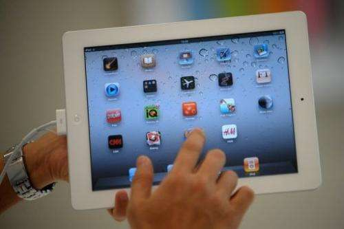 A man navigates through an iPad 2 on April 29, 2011