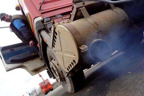 A mechanic starts up a 1989 truck with no particulate limiter on March 13, 2013 in Spay, western France