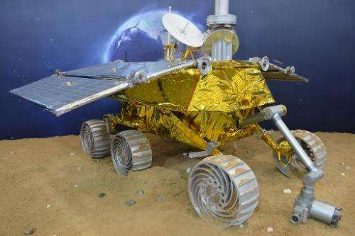 A model of a lunar rover that will explore the moon's surface in an upcoming space mission is seen on display at the China Inter