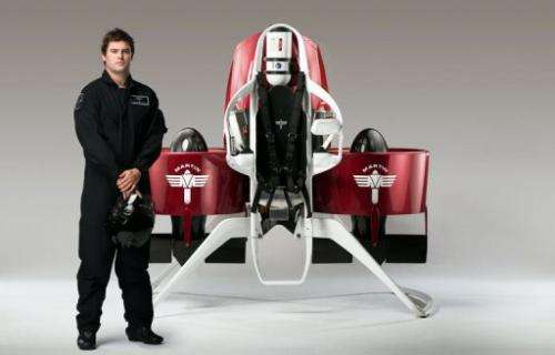 A model stands next to a newly developed personalised jetpack in Christchurch, New Zealand, pictured August, 2013