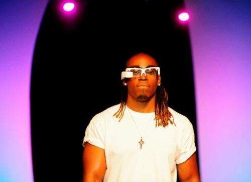 A model wears a pair of ORAS augmented reality digital eyewear at the Glazed Conference in San Francisco on September 30, 2013