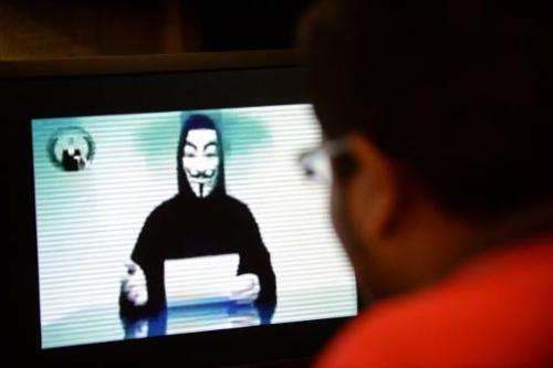 An Anonymous spokesman issues a warning online to the Singapore government over Internet licensing rules, on November 1, 2013