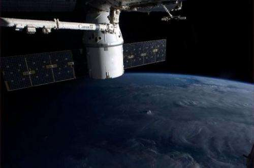 A NASA image taken on the International Space Station shows part of the ISS and Earth, on March 9, 2013