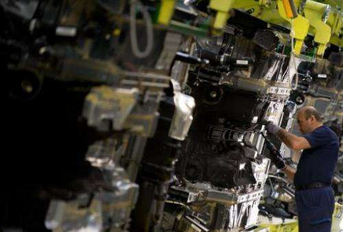 An employee is pictured as he works on the new Mercedes-Benz S-Class  in the plant of German auto giant Daimler