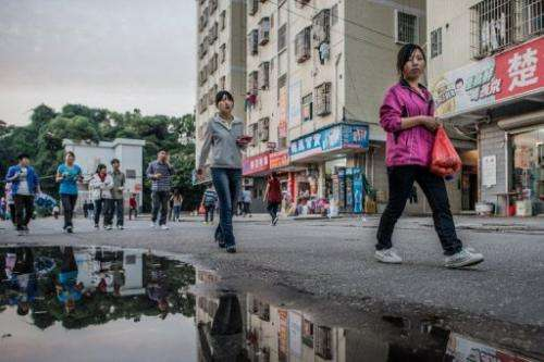 An employee of Taiwanese electronics manufacturer Foxconn in Shenzhen, China on October 31, 2012