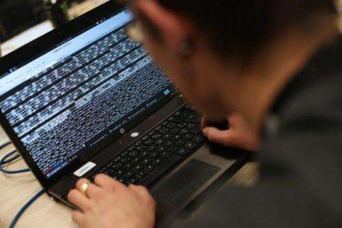 An engineering student types on his computer on March 16, 2013 in Meudon, Paris
