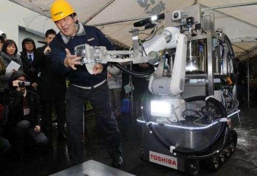 An engineer of Toshiba displays a decontamination robot in Yokohama, suburban Tokyo on February 15, 2013