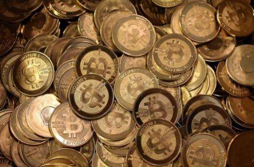 A pile of Bitcoin slugs sit in a box ready to be minted by Software engineer Mike Caldwell in his shop on April 26, 2013