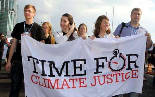 A rally in Doha on December 1, 2012 to demand urgent action on climate change