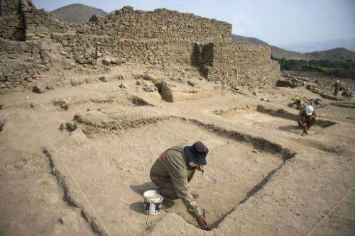 Archaeologists work at the El Paraiso archaeological site in Lima on February 14, 2013