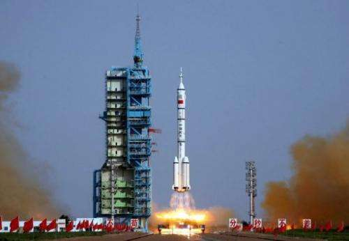 A Shenzhou-9 rocket blasts off from the Jiuquan space base in the remote Gobi desert on June 16, 2012.