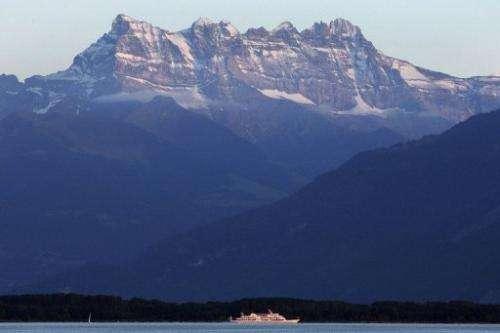 A ship sails on Lake Geneva under the Dents du Midi in western Switzerland on July 12, 2007