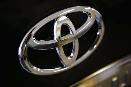 A Toyota logo hangs on a vehicle for sale at Northbrook Toyota on October 2, 2012 in Northbrook, Illinois