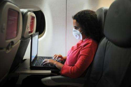 A uses a laptop during a flight from Guatemala to Mexico on April 28, 2009