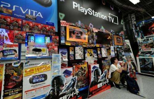 A videogame fan plays Sony's portable videogame console at a shop in Tokyo, Japan on February 20, 2013