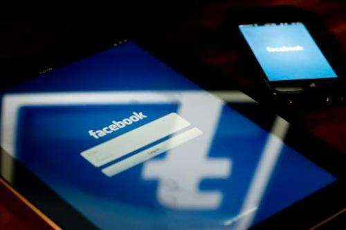 A view of an Apple iPad and iPhone displaying the Facebook app's splash screen May 10, 2012 in Washington, DC