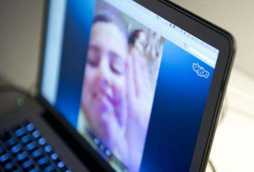A woman communicates with her family abroad by using Skype, in Stockholm, on August 26, 2013