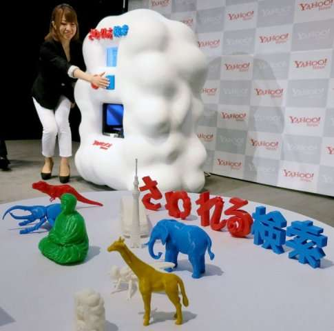 A woman demonstrates a voice-activated Internet search engine linked to a 3D printer in Tokyo on September 17, 2013