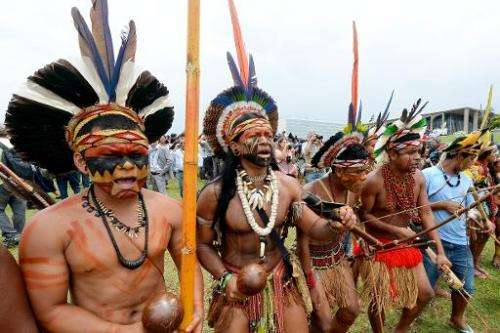 Brazilian natives demonstrate in front of the National Congress in Brasilia on October 3, 2013