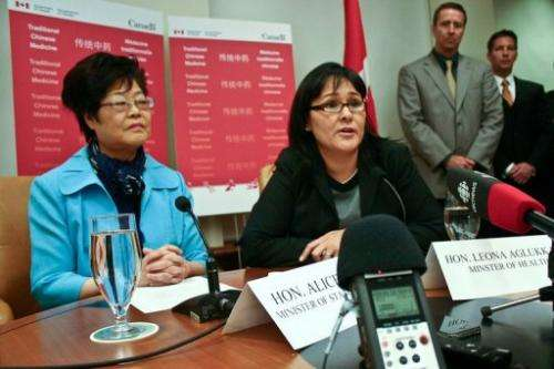 Canadian Health Minister Leona Aglukkaq (R) and the Canadian minister of state (L) speak on October 14, 2011, Vancouver