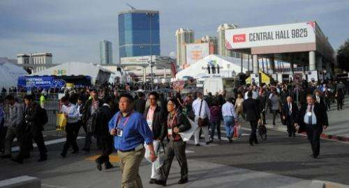 Consumers move between exhibition halls at the 2013 International CES on January 9, 2013 in Las Vegas, Nevada