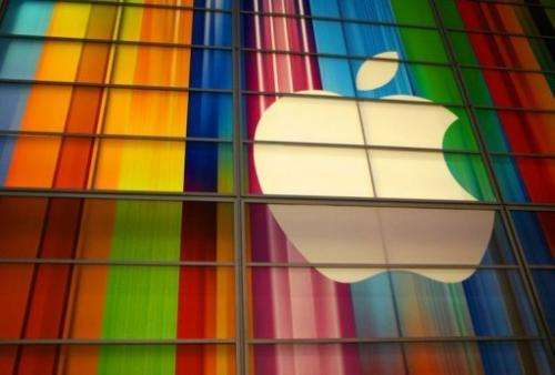 """Corporate raider Carl Icahn said Tuesday he has taken a """"large position"""" in Apple"""