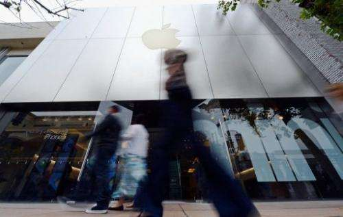 Customers and pedestrians walk in front of the Apple store at The Grove on January 23, 2013 in Los Angeles, California
