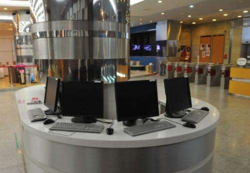 Disconnected computer monitors are seen at the Korean Broadcasting System headquarters in Seoul on March 20, 2013