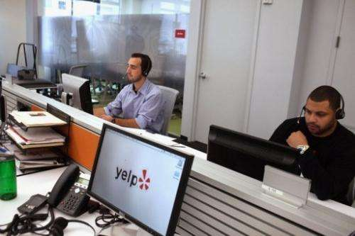 Employees of the online review site Yelp work in New York City on October 26, 2011