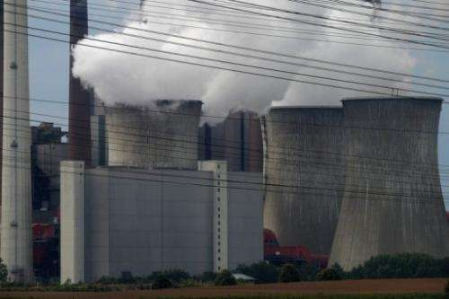 Exhaust rises from cooling towers of a coal-fired power station at Grevenbroich near Aachen on September 11, 2012