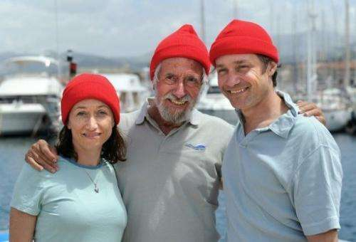 Fabien Cousteau (R) poses with father Jean-Michel and sister Céline on an islet off of Marseille on June 10, 2011