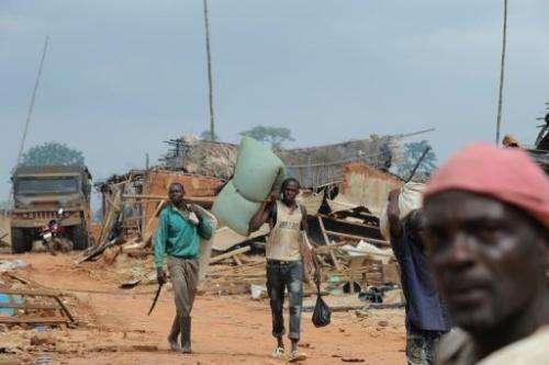 Farmers leave Baleko-Niegre village in southwestern Ivory Coast, on June 22, 2013