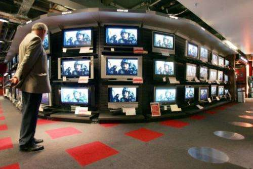 File picture for illustration shows a customer looking at television setsin a department store