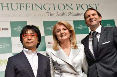 Founder Arianna Huffington (centre)  in Tokyo on May 7, 2013 at the launch of The Huffington Post's Japanese edition