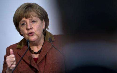 German Chancellor Angela Merkel addresses guests during a function in Berlin on February 20, 2013