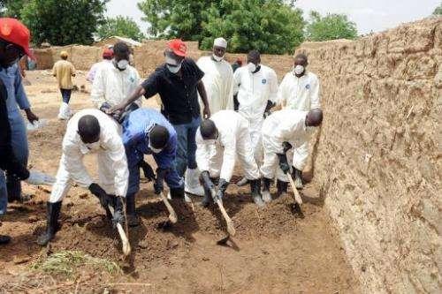 Health workers excavate contaminated soil at Dareta village, Anka district in Zamfara State on June 10, 2010