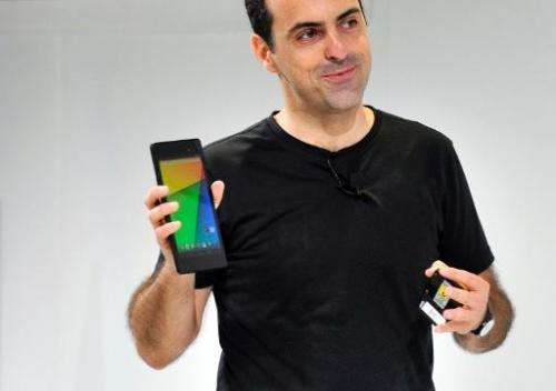 Hugo Barra, Vice President, Android Management at Google, displays a new Asus Nexus 7 tablet during a media event at Dogpatch St