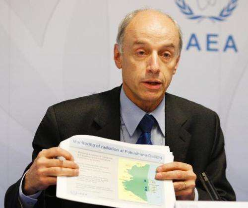 IAEA Deputy Director Denis Flory talks to the press after a meeting on March 14, 2011 in Vienna