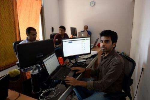 Indian software developer Nischal Shetty (right) at his office in Vashi, on May 7, 2013