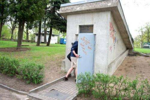In Riga on May 10, 2013, a man enters an ex-Soviet bunker now hosting servers of cloud computing company DEAC
