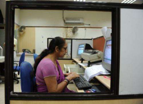 In this picture taken on July 10, 2013 a worker types a telegram at the Central Telegraph Office in New Delhi