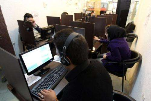 Iranians surf the net at a cyber at a cafe in Tehran on in 2011