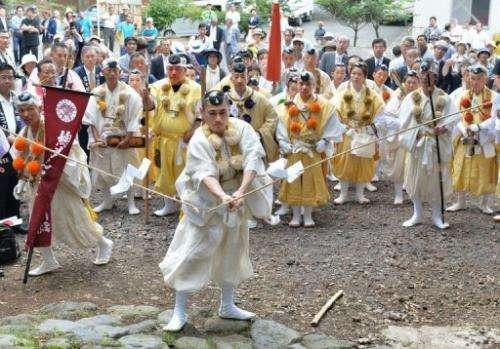 Japanese Buddhist monks mark the official opening of Mount Fuji climbing season at Murayama Sengen Shrine, July 1, 2013