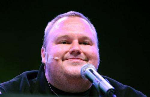 Kim Dotcom smiles during the launch of his new website at a press conference in Auckland on January 20, 2013