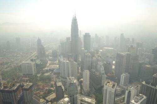 Kuala Lumpur's skyline is seen covered by haze, on June 27, 2013