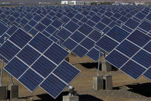 Large solar panels in a solar power plant in Hami, northwest China's Xinjiang Uygur Autonomous Region on May 8, 2013