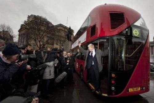 London Mayor Boris Johnson introduces a new prototype London bus using hybrid technology in London on December 16, 2011