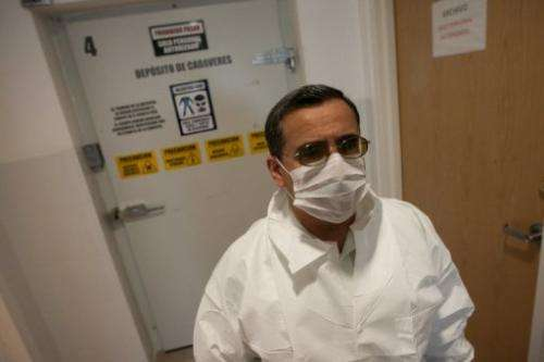 Mexican dentist Alejandro Hernandez Cardenas speaks with reporter about the procedure in Ciudad Juarez on March 6, 2013