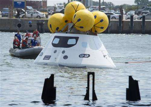 NASA, Navy practice space-capsule recovery